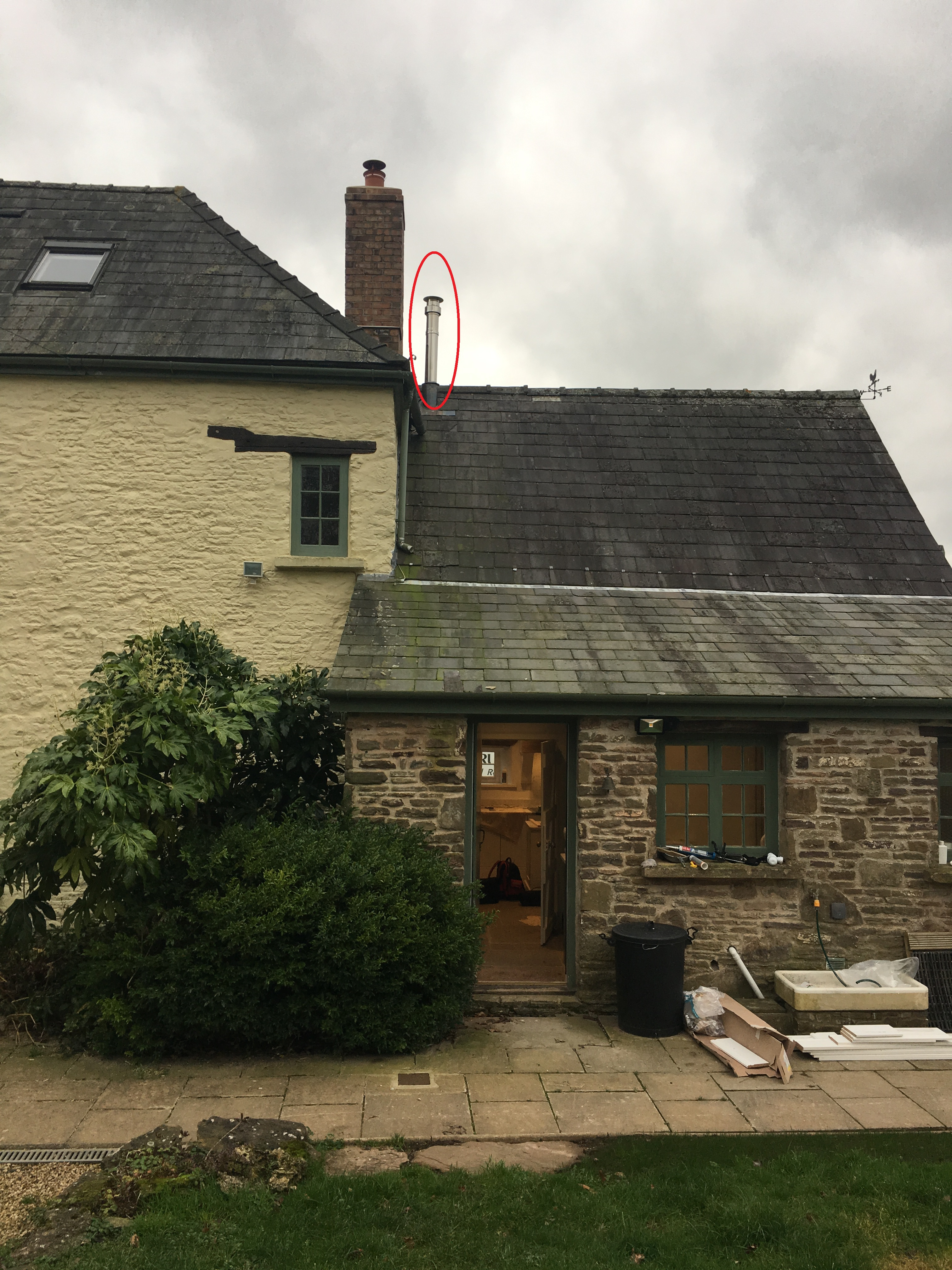 Low chimney height when in close proximity to higher roofs and chimneys